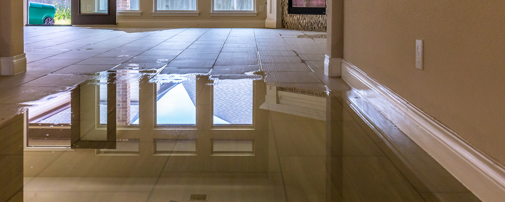 A tiled floor covered with water representing the flood solutions of John J. Cahill Inc. in Evanston, IL