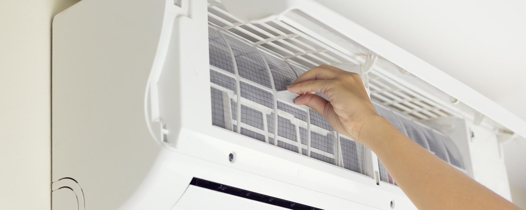 Homeowner Adjusting Indoor HVAC Unit